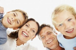 family of dental clients with a dentist whos goal is to help them achieve optimal oral health and keep their teeth for life with a comprehensive menu of family dentistry services.